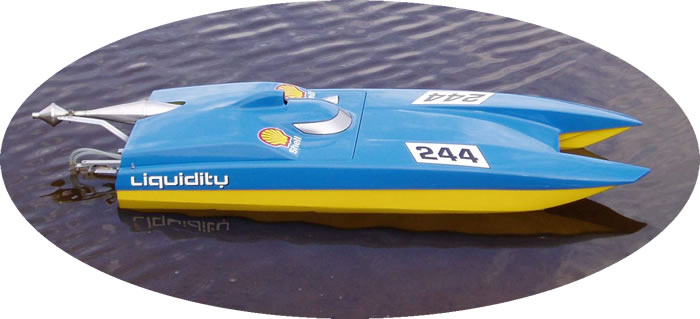 Photo of Liquidity, an Aeromarine Avenger Cat radio controlled model race boat. This Exelbay-Racing RC model racing boat is an AMPBA 15cc to 25cc Petrol Cat Class and can achieve speeds of 95 kph